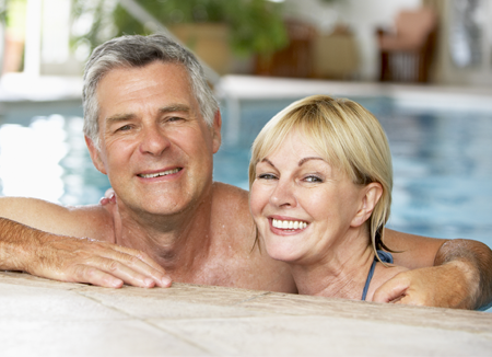 Happy Older Couple in a Pool with White Teeth in Raleigh, NC